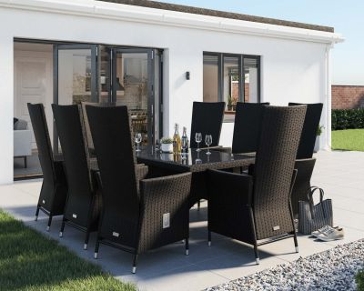 Side View Of Black And Vanilla Rattan Dining Set With 8 Recliners