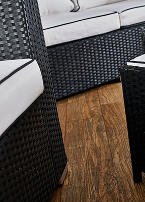 black rattan furniture with vanilla cushions