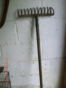 Store rakes and hoes 'heads up' against a wall. Keep safe in your garden