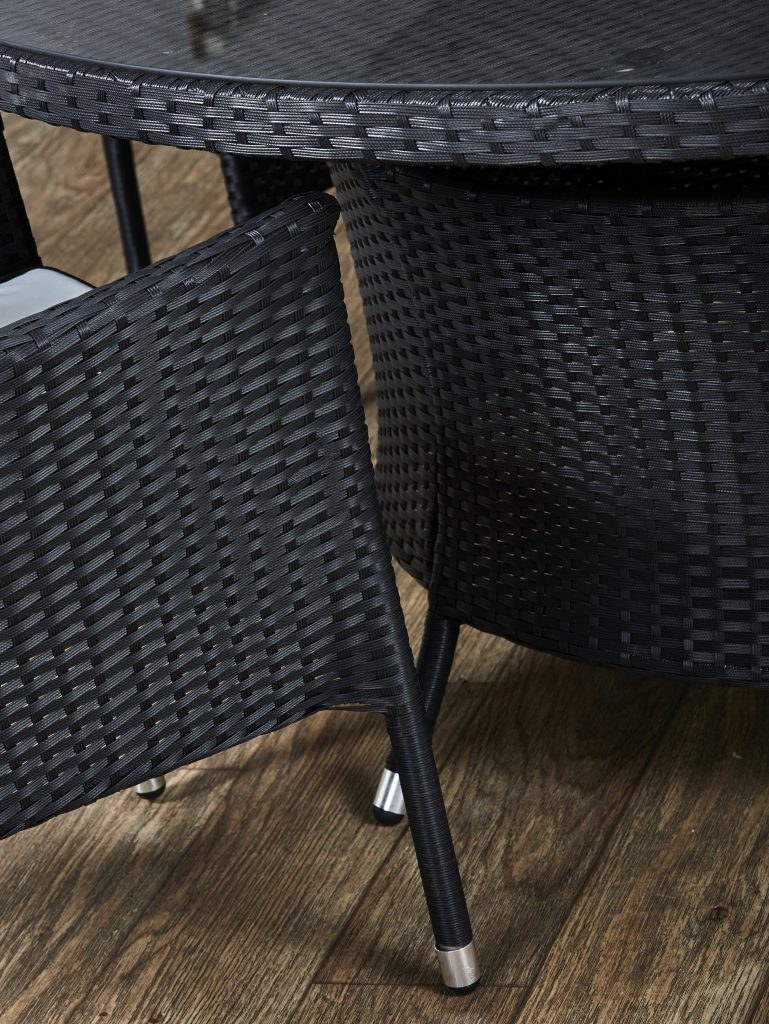 Black rattan table and chair. Rattan garden furniture