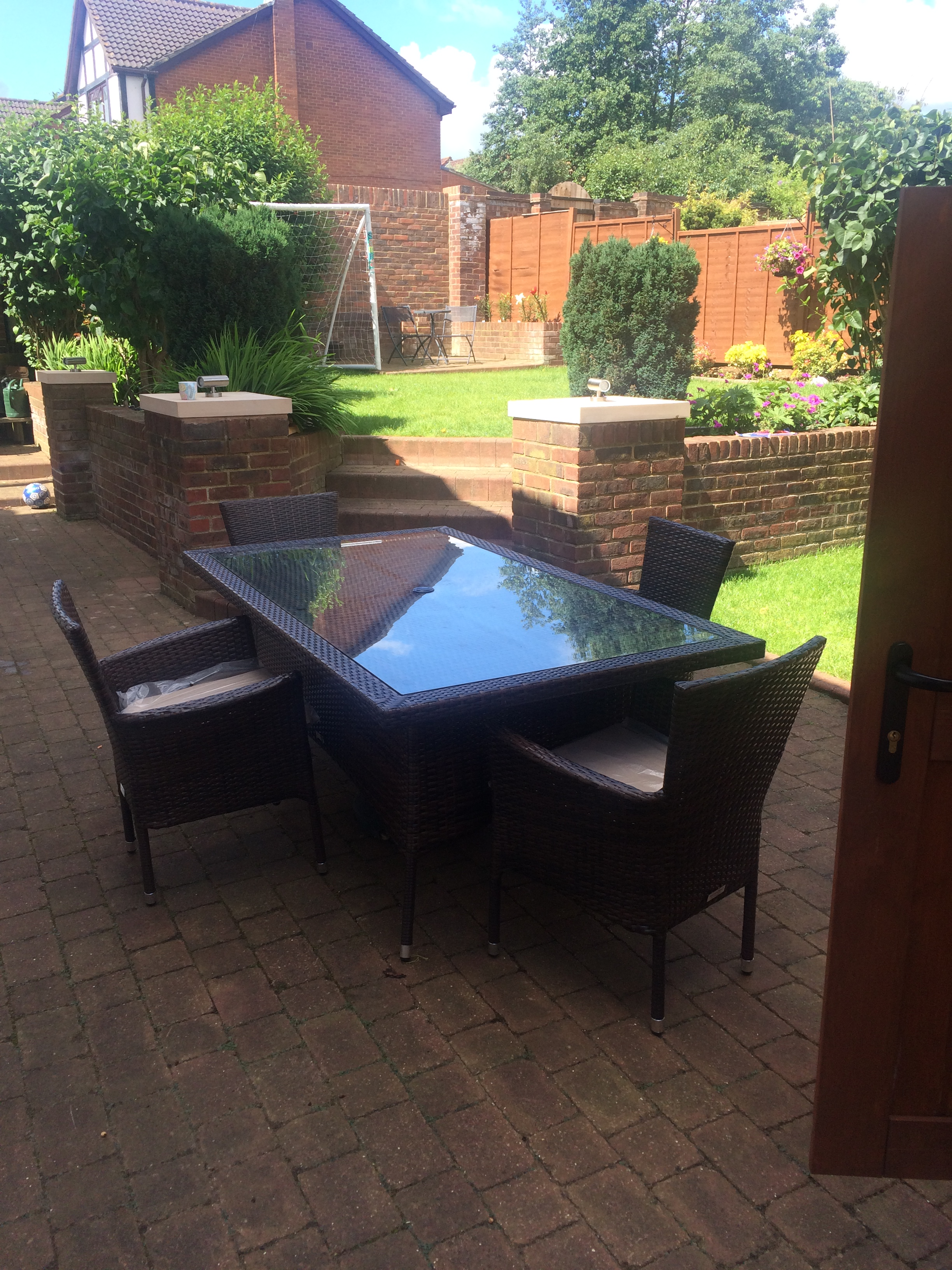 Be ready for sunshine with an outdoor dining set and free parasol